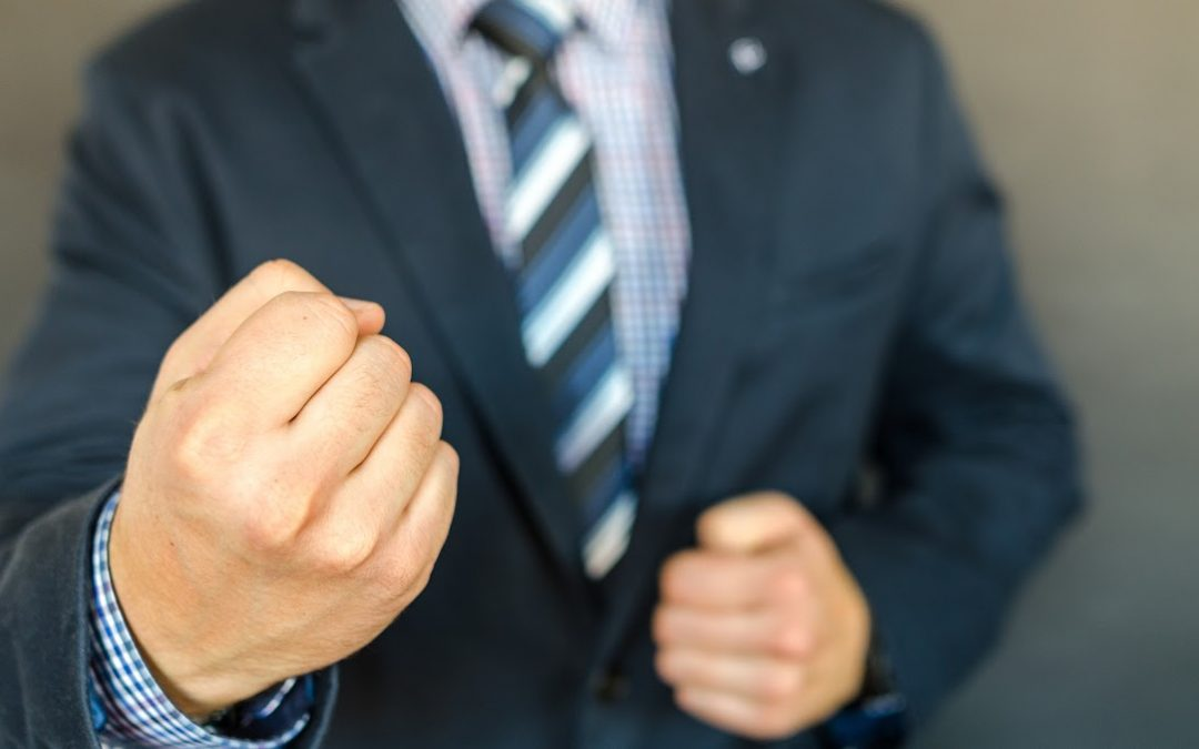 Business man with clinched fist