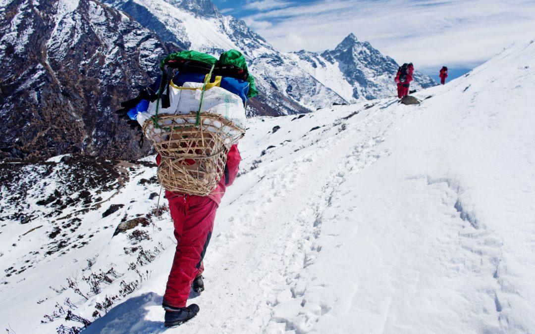 Walking up glacier with backpack